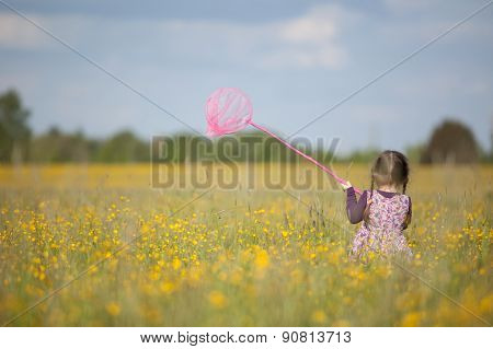 Girl With Butterfly Net In Field Of Yellow Flowers