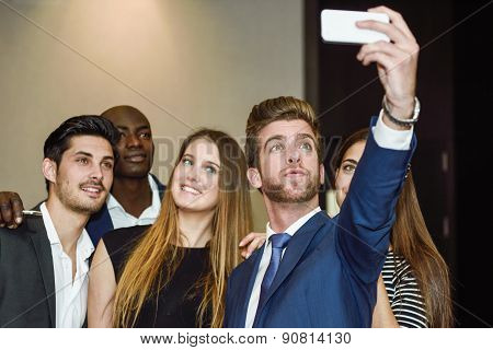 Group Of Multi-ethnic Businesspeople Taking A Picture