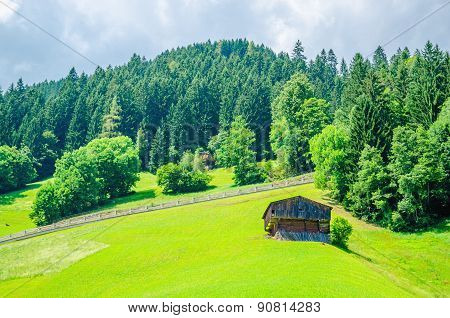 Green meadows and high peaks of mountains, Austria