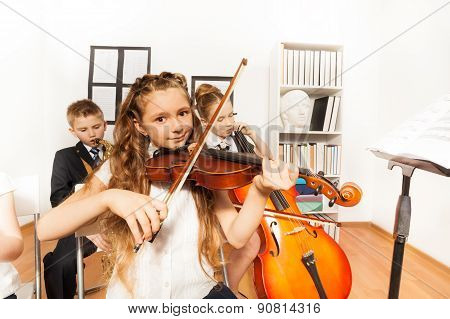 Performance of kids playing musical instruments