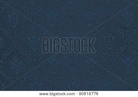 Seamless Pattern Of Flowers On A Dark Blue Fabric