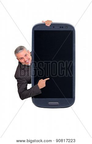 Brazilian business man pointing to a smartphone. Idea of digital teaching, smartphone sellings, app ads, taking shots, accessing apps, Internet, blogs and others.