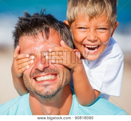 boy with father playing at the beach