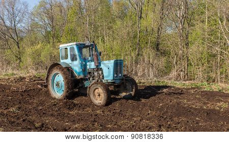 Tractor plowing