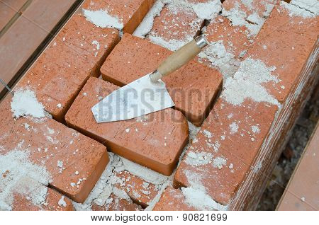 Mason Bricklaying Background With Trowel And Brick Blocks