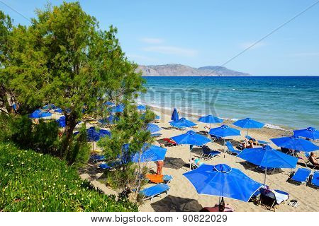 Crete, Greece - May 13: The Tourists Enjoiying Their Vacation On The Beach On May 13, 2014 In Crete,