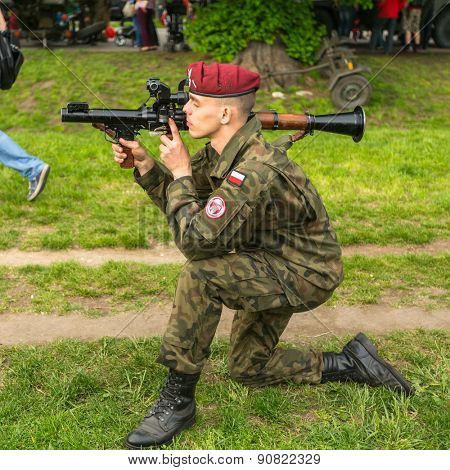KRAKOW, POLAND - MAY 3, 2015: Polish soldier during demonstration of the military and rescue equipment in the framework annual Polish national and public holiday the Constitution Day May 3rd.