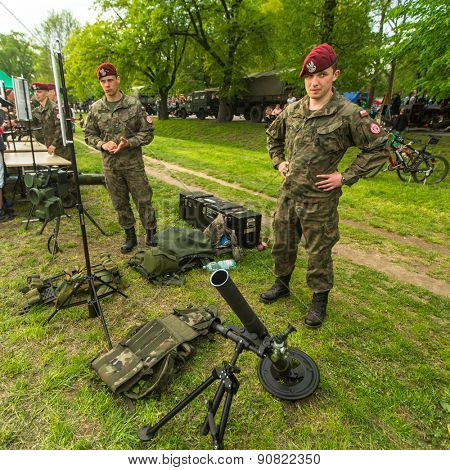 KRAKOW, POLAND - MAY 3, 2015: Polish soldiers during demonstration of the military and rescue equipment in the framework annual Polish national and public holiday the Constitution Day May 3rd.