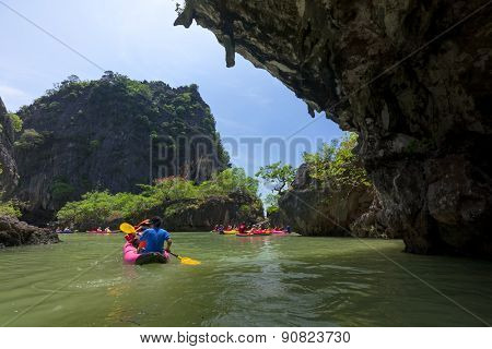 MARCH 12, 2008 - PHUKET, THAILAND: Tourists visit the limestone caves in the islands near Phuket. This is a popular tourist destination and the caves can only be entered from the sea with canoes.