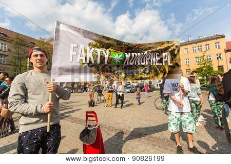 KRAKOW, POLAND - MAY 9, 2015: Unidentified participants of the March For Cannabis Liberation. Marijuana Marches is a global movement manifesto fighting for a rational approach towards hemp plant.