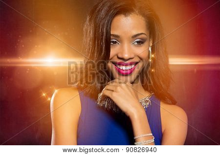 Beautiful young fashion woman wearing blue dress in warm lights