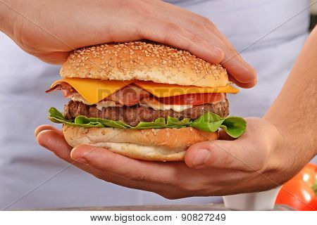 Cook hands holding and preparing hamburger.