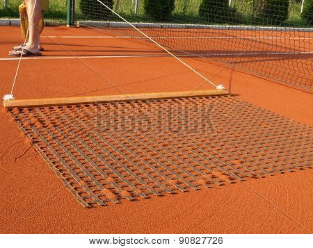 Sweeping the tennis Court