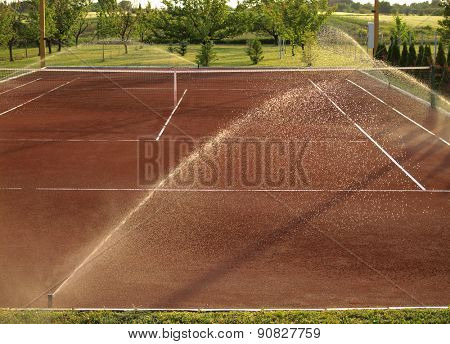 Tennis court watering