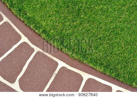 Stenciled Concrete Floor And Green Artificial Grass