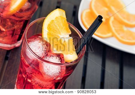 Close-up Of View Of Glasses Of Spritz Aperitif Aperol Cocktail With Orange Slices And Ice Cubes