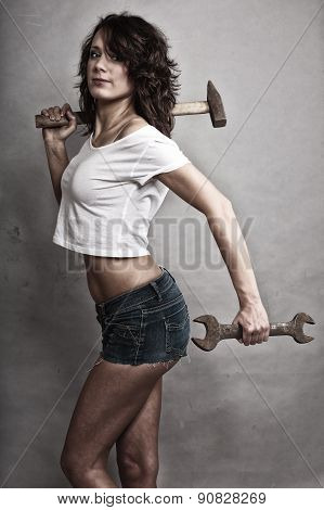 Sexy Woman Holding Hammer And Wrench Spanner