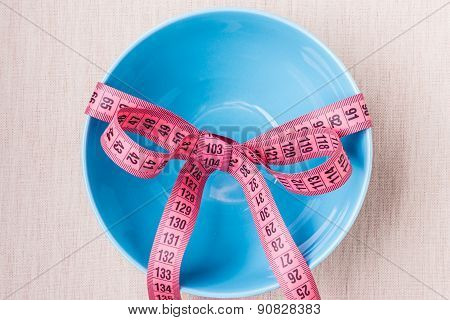 Measuring Tape Around Empty Bowl On Table