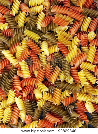 Fusilli italian pasta background, close-up