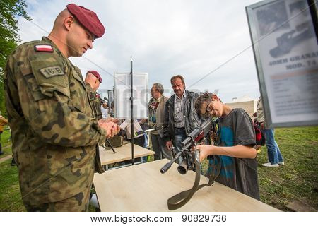 KRAKOW, POLAND - MAY 3, 2015: Unidentified child during demonstration of the military and rescue equipment in framework annual Polish national and public holiday Constitution Day May 3rd.