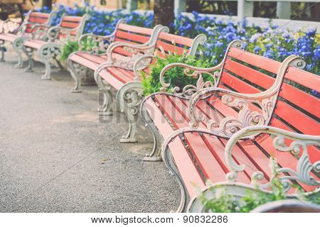 Vintage Brown Wooden Bench In The Garden