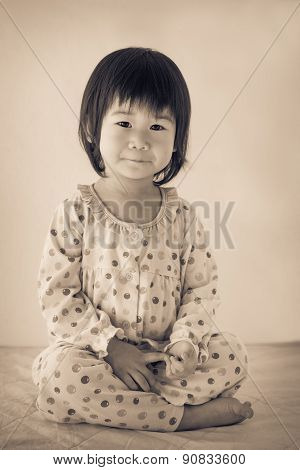 Little Asian (thai) Girl Sitting. Vintage And Retro Picture Style