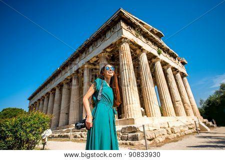 Woman with photo camera near Hephaistos temple in Agora