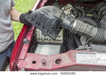 A Mechanic Checking A Air Filter On A Truck