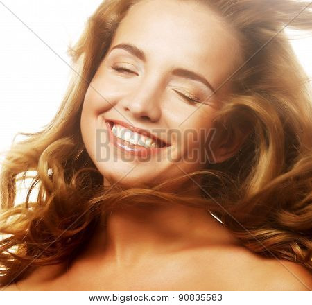 Sensual woman with windswept flying blond hair.