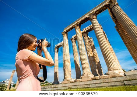 Woman photographing Zeus temple in Acropolis