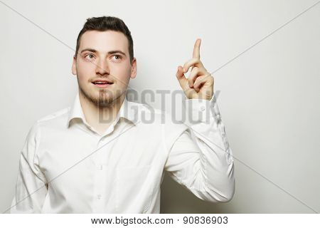 life style, business  and people concept: business man pointing up finger. Isolated on white background/
