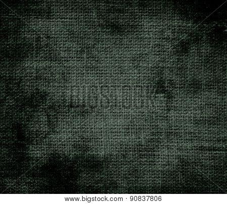 Grunge background of black leather jacket burlap texture
