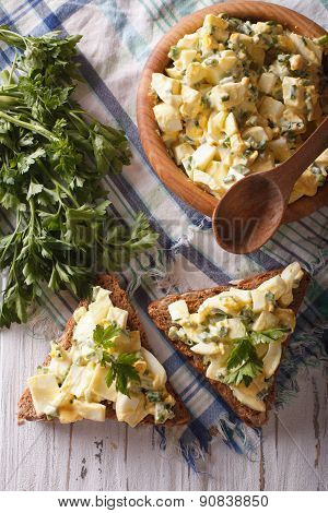 Bread And Egg Salad Close-up. Vertical Top View