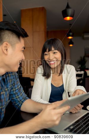 Asian Couple In Cafe