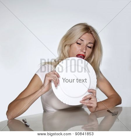 Blond woman licking plate.