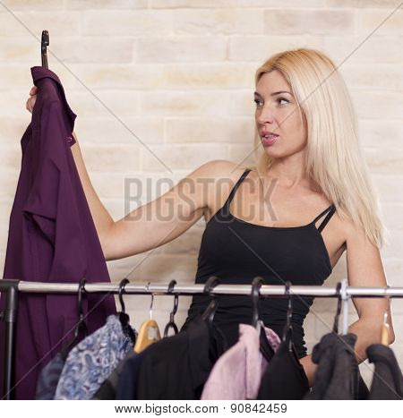 Woman looking at clothing on rail