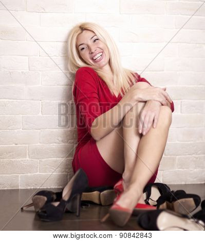 Woman surrounded by shoes