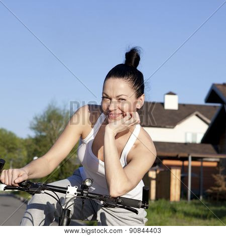 Portrait of happy young bicyclist riding in park