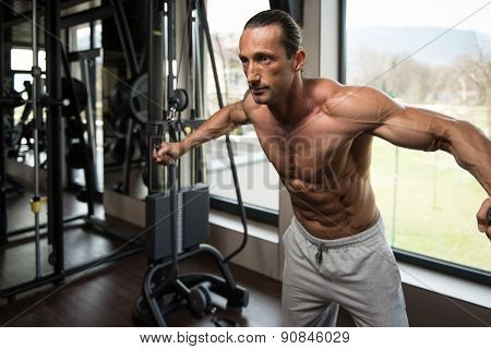 Bodybuilder Doing Exercise For Chest