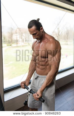 Bodybuilder Doing Heavy Weight Exercise For Biceps
