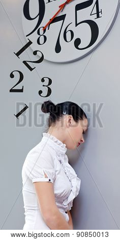 Business Woman under the clock. Concept