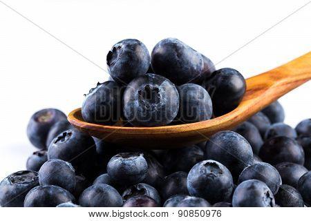 Fresh Blueberries In Wooden Spoon