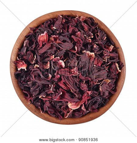 Dried Petals Of Hibiscus In A Wooden Bowl On A White