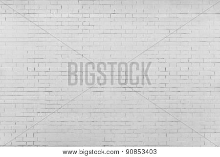 The Pale Gray Textured Surface Of A Brick Wall