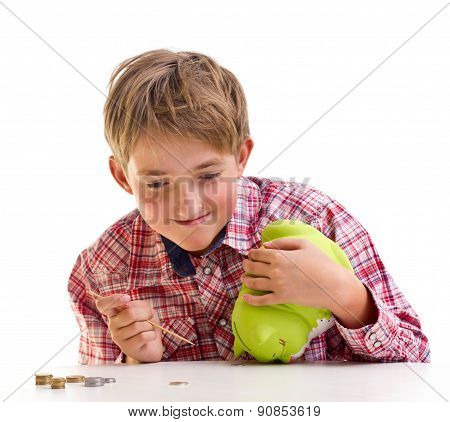 The boy gets money from the piggy bank