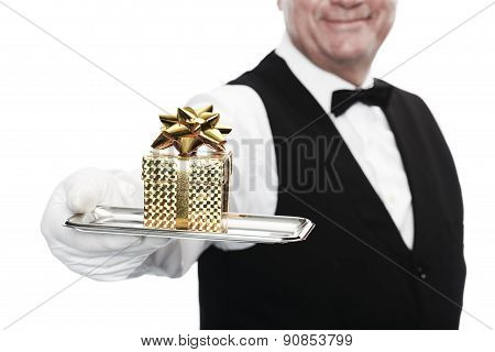 Butler holding tray with gift