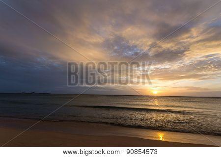 Golden Sunrise On Desert Beach