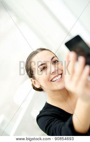 Happy Woman Taking A Selfie On Her Mobile