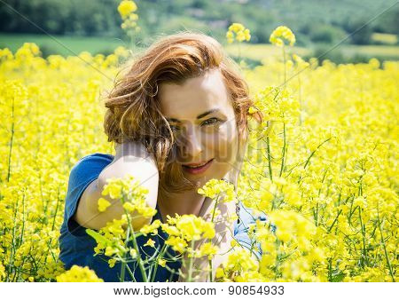 Lovely Young Brunette In Rapeseed Field