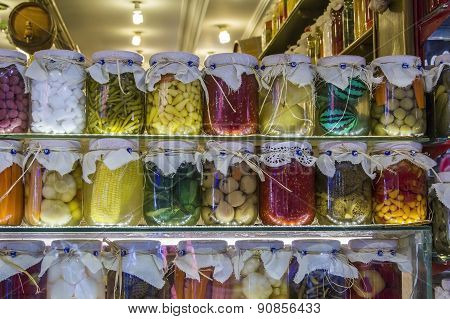 jars of pickled vegetables and fruits at the market